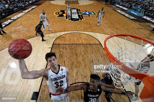 Zach Collins of the Gonzaga Bulldogs goes in for a layup over Chris Silva of the South Carolina Gamecocks during the 2017 NCAA Photos via Getty...