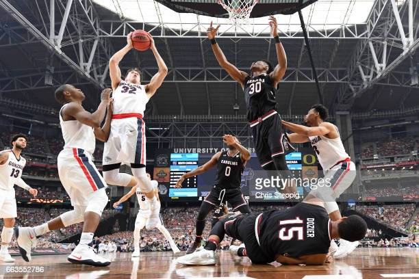 Zach Collins of the Gonzaga Bulldogs grabs a rebound during the 2017 NCAA Men's Final Four Semifinal against the South Carolina Gamecocks at...