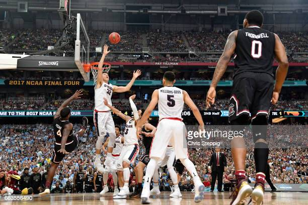 Zach Collins of the Gonzaga Bulldogs reaches for a defensive rebound during the 2017 NCAA Men's Final Four Semifinal against the South Carolina...