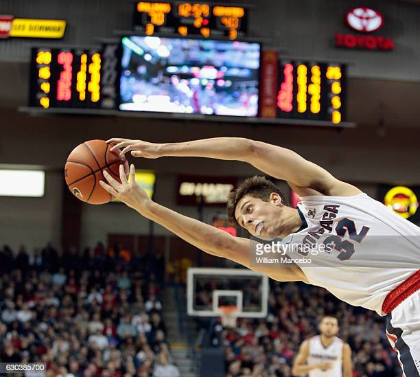 Zach Collins of the Gonzaga Bulldogs reaches for an offensive rebound against the South Dakota Coyotes in the second half at McCarthey Athletic...