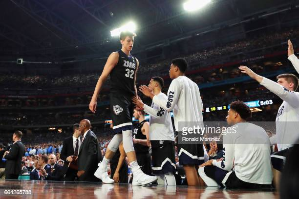 Zach Collins of the Gonzaga Bulldogs walks to the bench after fouling out in the second half against the North Carolina Tar Heels during the 2017...