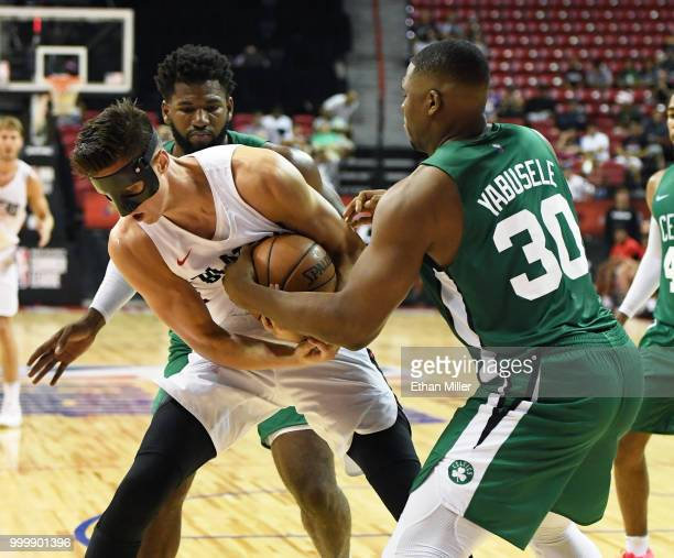 Zach Collins of the Portland Trail Blazers and Guerschon Yabusele of the Boston Celtics fight for a rebound during a quarterfinal game of the 2018...