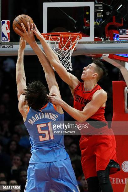 Zach Collins of the Portland Trail Blazers blocks the shot from Boban Marjanovic of the LA Clippers during the first half of the game at the Staples...
