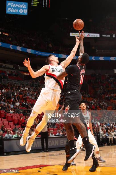 Zach Collins of the Portland Trail Blazers goes up for a rebound against the Miami Heat on December 13 2017 at American Airlines Arena in Miami...