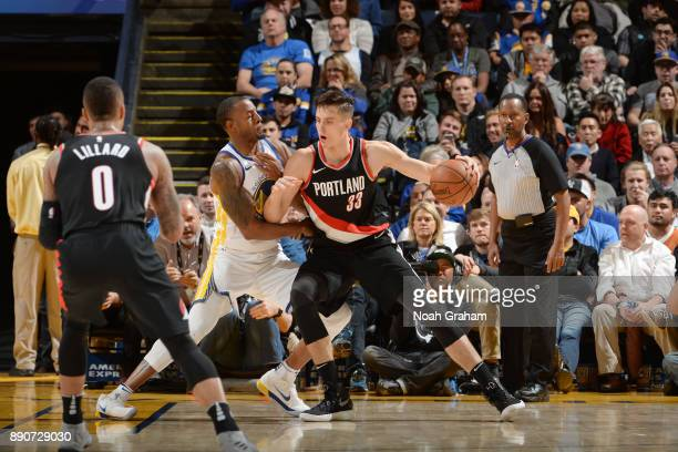 Zach Collins of the Portland Trail Blazers handles the ball against the Golden State Warriors on December 11 2017 at ORACLE Arena in Oakland...
