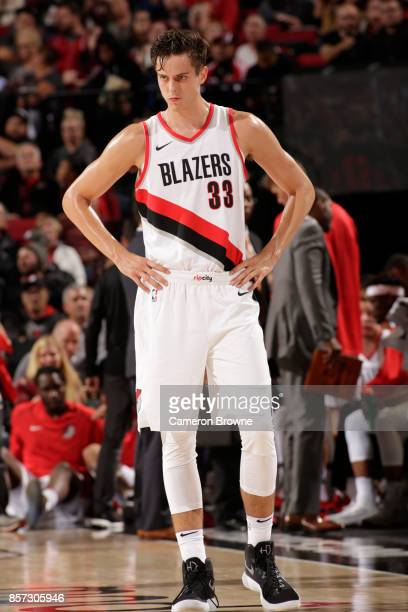 Zach Collins of the Portland Trail Blazers looks on during a preseason game against the Phoenix Suns on October 3 2017 at the Moda Center in Portland...