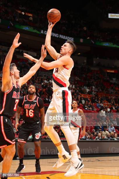 Zach Collins of the Portland Trail Blazers shoots the ball against the Miami Heat on December 13 2017 at American Airlines Arena in Miami Florida...