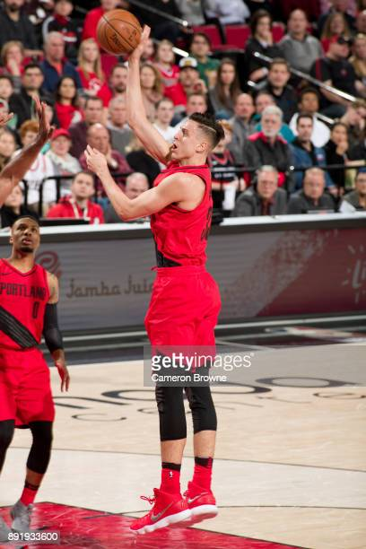 Zach Collins of the Portland Trail Blazers shoots the ball during the game against the Houston Rockets on December 9 2017 at the Moda Center Arena in...