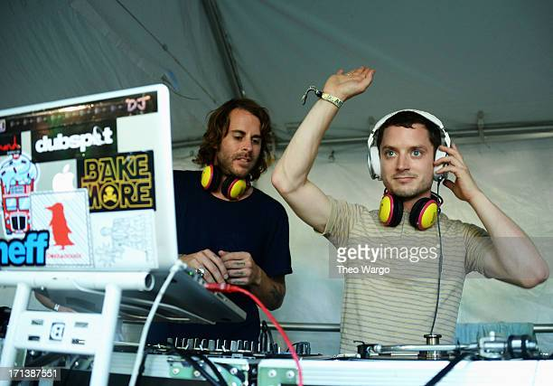 Zach Cowie and Elijah Wood spin onstage at the Firefly Music Festival at The Woodlands of Dover International Speedway on June 23, 2013 in Dover,...