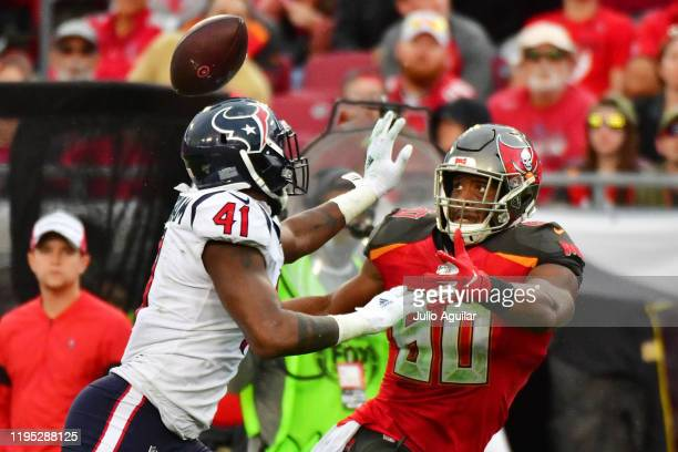 Zach Cunningham of the Houston Texans breaks up a pass intended for O.J. Howard of the Tampa Bay Buccaneers during the fourth quarter of a football...