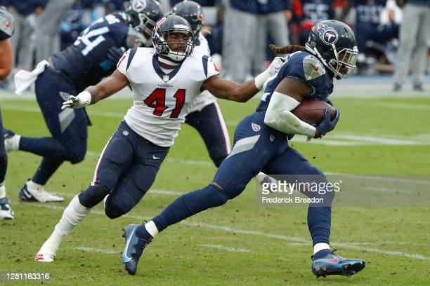 Zach Cunningham of the Houston Texans chases Derrick Henry of the Tennessee Titans at Nissan Stadium on October 18, 2020 in Nashville, Tennessee.