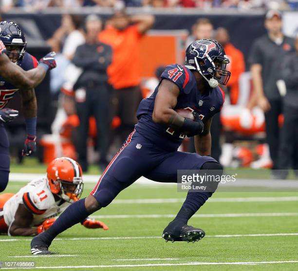 Zach Cunningham of the Houston Texans intercepts a pass and returns for a touchdown from Baker Mayfield of the Cleveland Browns at NRG Stadium on...