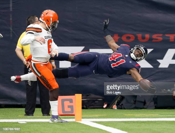 Zach Cunningham of the Houston Texans intercepts Baker Mayfield of the Cleveland Browns for a touchdown in the second quarter at NRG Stadium on...