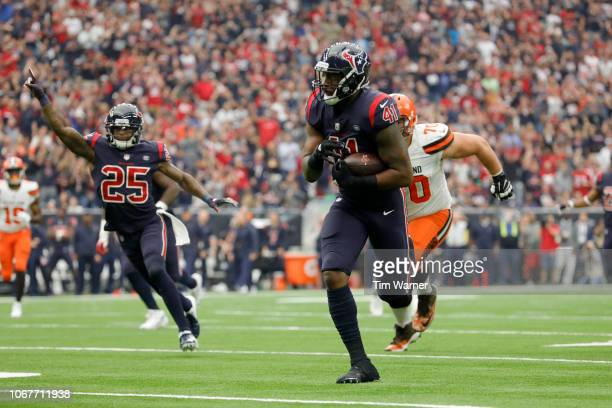 Zach Cunningham of the Houston Texans intercepts the ball and runs for a touchdown against the Cleveland Browns in the second quarterat NRG Stadium...