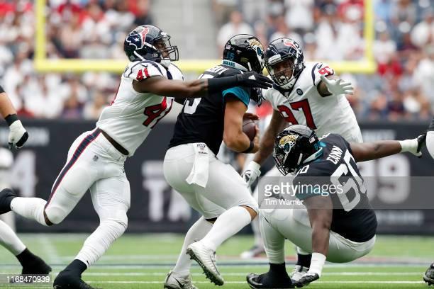 Zach Cunningham of the Houston Texans sacks Gardner Minshew of the Jacksonville Jaguars in the first quarter at NRG Stadium on September 15, 2019 in...
