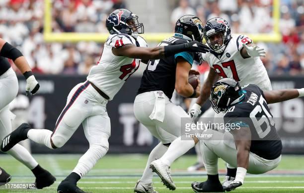 Zach Cunningham of the Houston Texans sacks Gardner Minshew of the Jacksonville Jaguars in the first half at NRG Stadium on September 15, 2019 in...