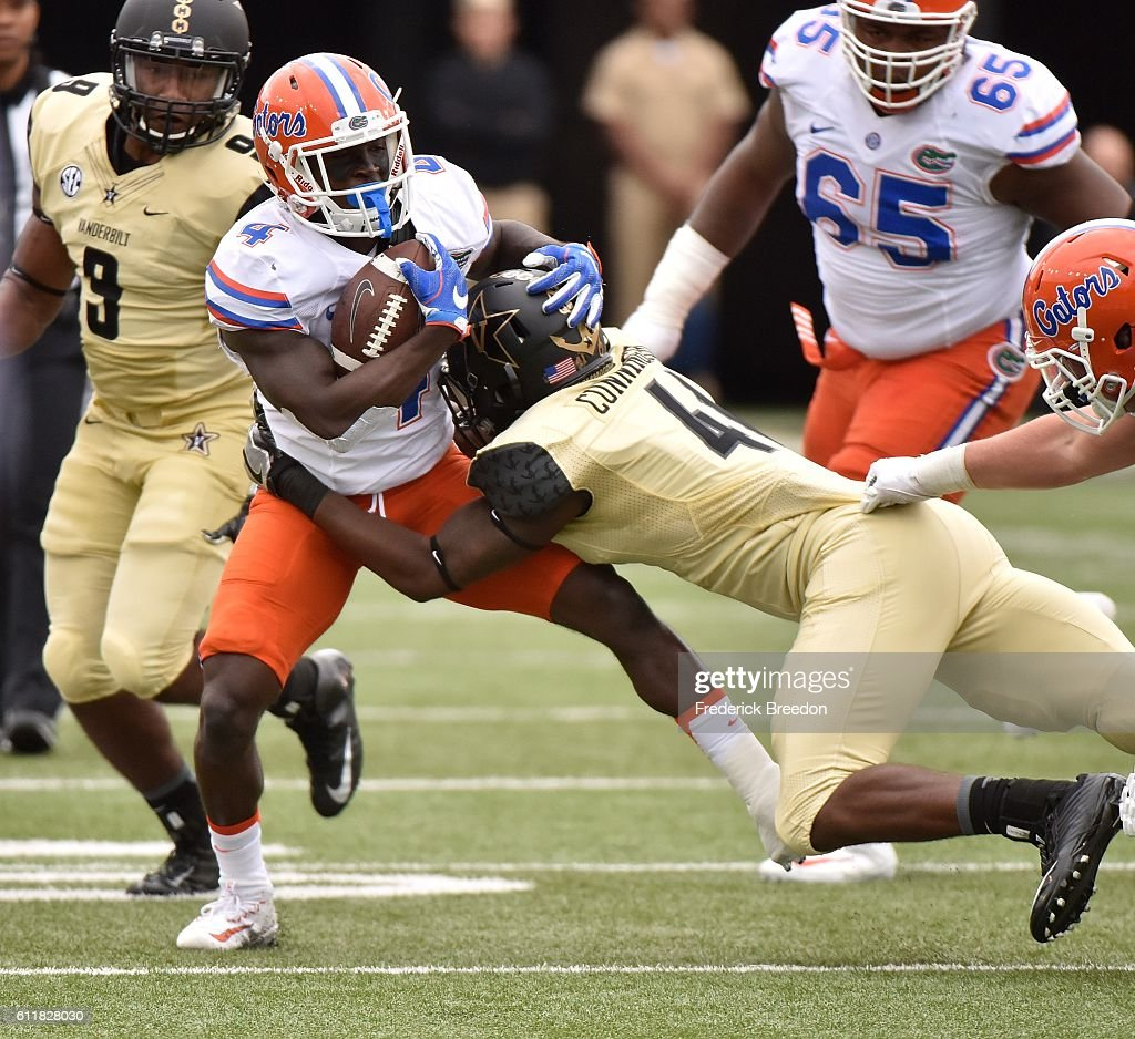 Zach Cunningham #41 of the Vanderbilt Commodores tackles Brandon Powell #4 of the Florida Gators during the first half at Vanderbilt Stadium on October 1, 2016 in Nashville, Tennessee.