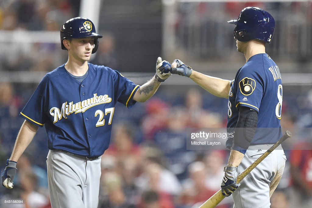 Zach Davies #27 of the Milwaukee Brewers celebrates with Ryan Braun #8 on scoring on Aaron Hill #9 (not pictured) home run in the seventh inning during a baseball game against the Washington Nationals at Nationals Park on July 5, 2016 in Washington, DC.