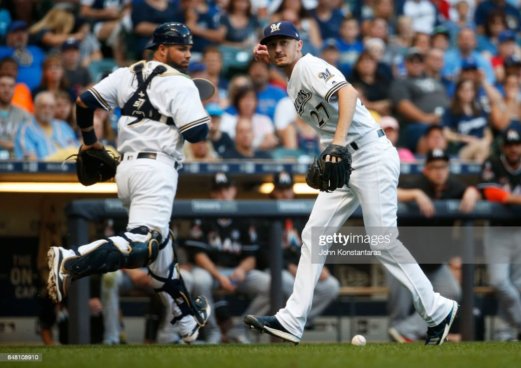 Zach Davies #27 of the Milwaukee Brewers misses a ball on a bunt by Dee Gordon #9 (not pictured) of the Miami Marlins during the first inning at Miller Park on September 16, 2017 in Milwaukee, Wisconsin.