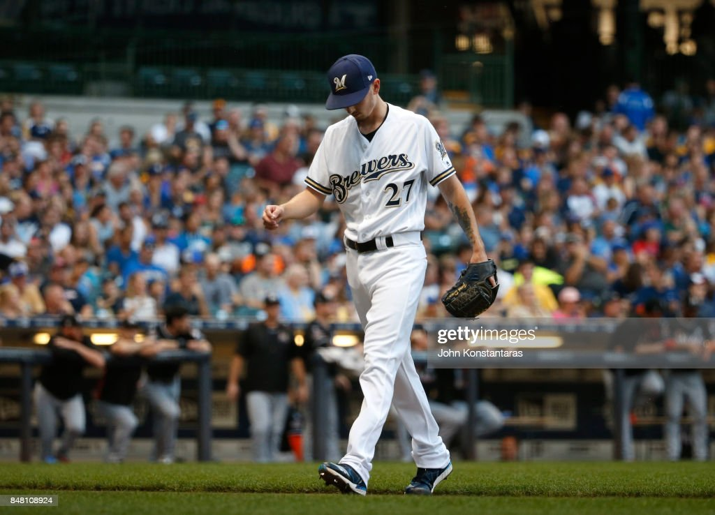 Zach Davies #27 of the Milwaukee Brewers walks off the mound after giving up 4 runs in the first inning against the Miami Marlins at Miller Park on September 16, 2017 in Milwaukee, Wisconsin.