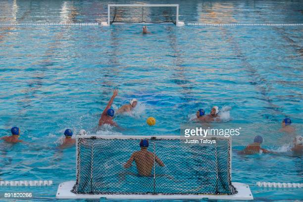 Zach D'sa of USC shoots the ball during the Division I Men's Water Polo Championship held at the Uytengsu Aquatics Center on the University of...