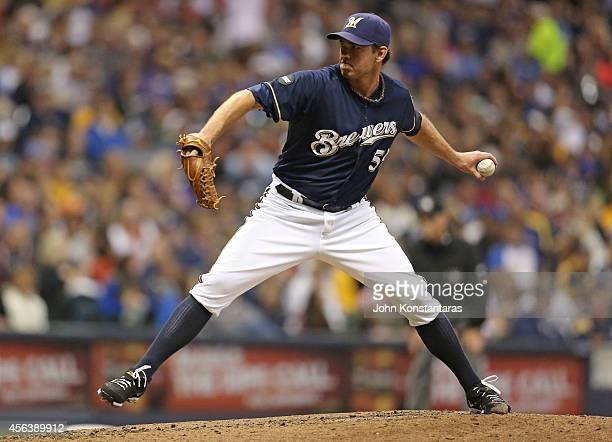 Zach Duke of the Milwaukee Brewers delivers a pitch during the seventh inning of their game against the Cincinnati Reds at Miller Park on September...