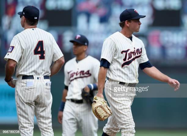 Zach Duke of the Minnesota Twins is pulled from the game against the Tampa Bay Rays by manager Paul Molitor during the seventh inning of the game on...