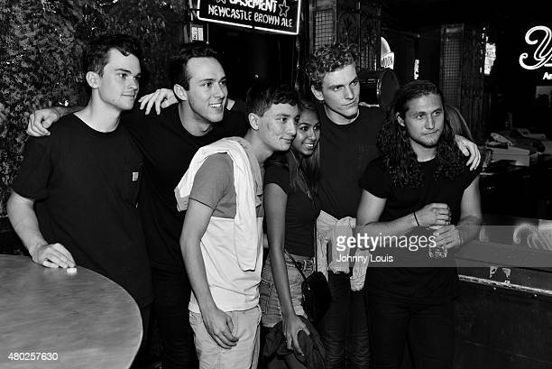 Zach Dyke, Ryan Winnen, Chase Lawrence and Joe Memmel of COIN pose for picture with fans during An Intimate Night Out at Revolution Live on July 9,...