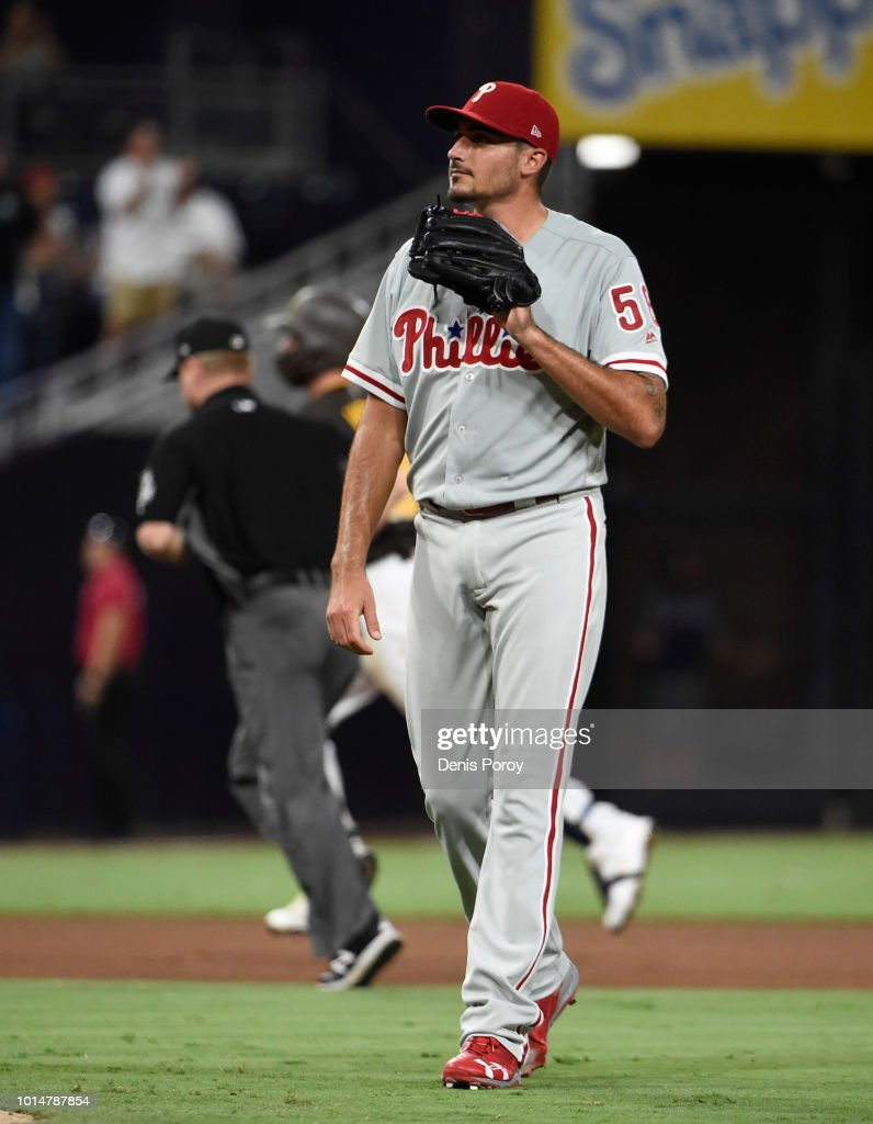 Zach Eflin #56 of the Philadelphia Phillies looks toward the plate after giving up a solo home run to Austin Hedges #18 of the San Diego Padres at PETCO Park on August 10, 2018 in San Diego, California.