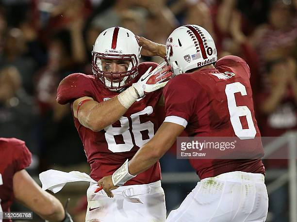 Zach Ertz and Josh Nunes of the Stanford Cardinal celebrate after Nunes threw the winning touchdown pass to Ertz during their game against the USC...