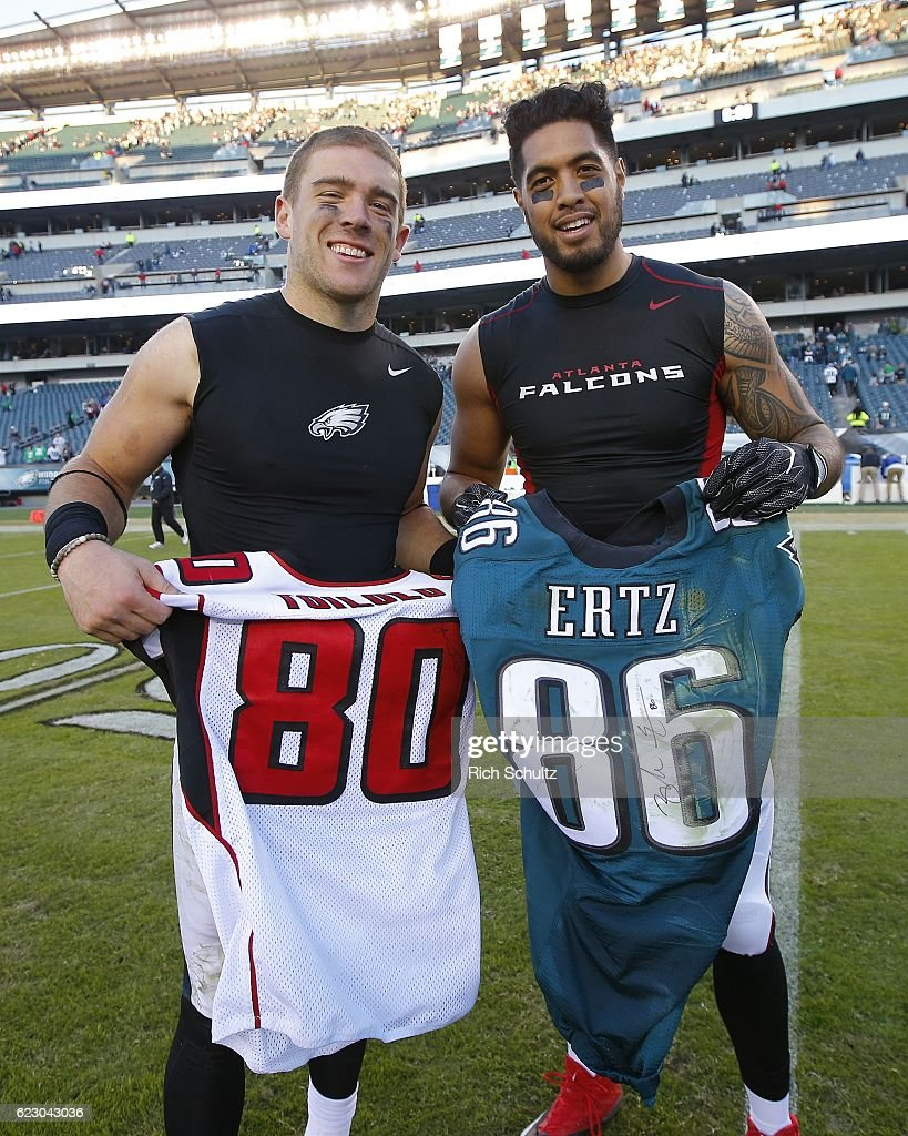 Zach Ertz #86, left, of the Philadelphia Eagles exchanges jerseys with former Stanford teammate Levine Toilolo #80 after their game at Lincoln Financial Field on November 13, 2016 in Philadelphia, Pennsylvania. The Eagles defeated the Falcons 24-15.