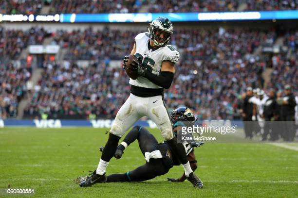 Zach Ertz of The Eagles catches a touchdown throw during the NFL International Series match between Philadelphia Eagles and Jacksonville Jaguars at...