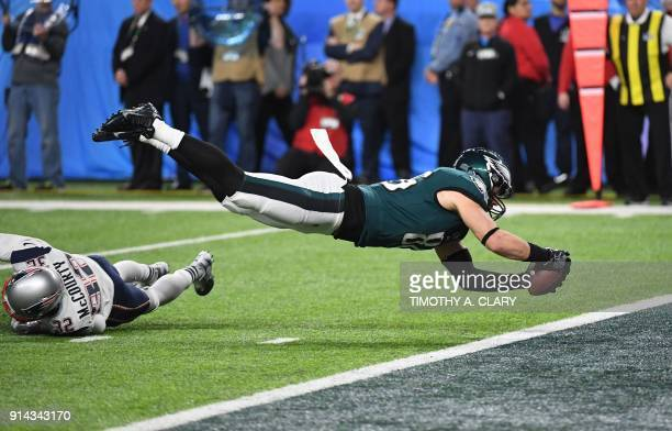 Zach Ertz of the Eagles dives for a score during Super Bowl LII between the New England Patriots and the Philadelphia Eagles at US Bank Stadium in...