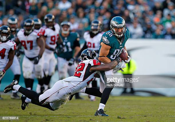 Zach Ertz of the Philadelphia Eagles attempts to break a tackle by Keanu Neal of the Atlanta Falcons after making a catch for a first down during the...