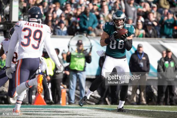 Zach Ertz of the Philadelphia Eagles catches a touchdown against Adrian Amos and Eddie Jackson of the Chicago Bears in the first quarter at Lincoln...