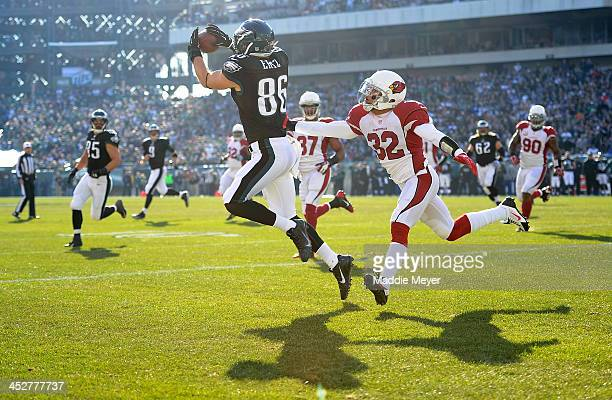 Zach Ertz of the Philadelphia Eagles catches a touchdown pass from Nick Foles as Tyrann Mathieu of the Arizona Cardinals prepares to tackle during...