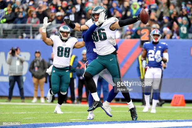 Zach Ertz of the Philadelphia Eagles celebrates after scoring a 10 yard touchdown against the New York Giants during the second quarter in the game...