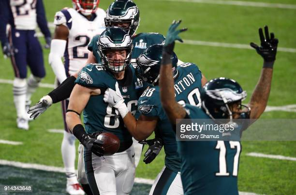 Zach Ertz of the Philadelphia Eagles celebrates his 11 yard touchdown catch with teammates Trey Burton and Alshon Jeffery during the fourth quarter...