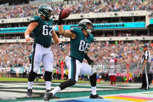Zach Ertz of the Philadelphia Eagles celebrates scoring a touchdown as teammate Jason Kelce looks on against the Arizona Cardinals during the first...