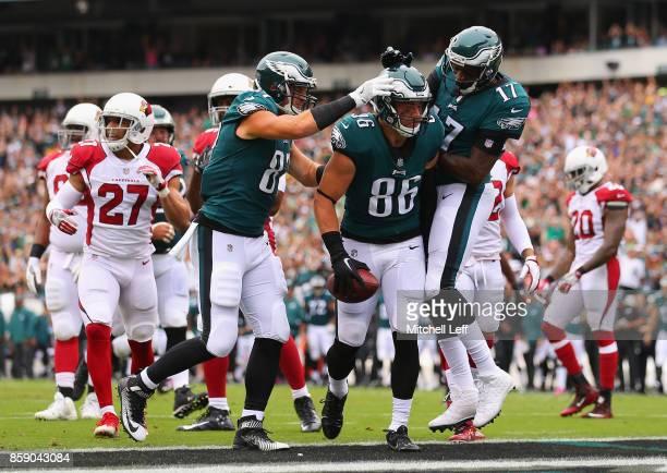 Zach Ertz of the Philadelphia Eagles celebrates scoring a touchdown against the Arizona Cardinals with teammates Brent Celek and Alshon Jeffery...