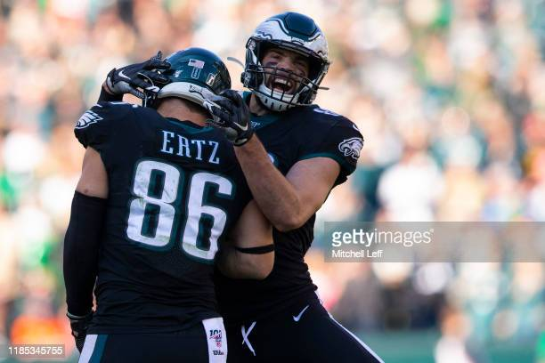 Zach Ertz of the Philadelphia Eagles celebrates with Dallas Goedert after Ertz scored a touchdown against the Chicago Bears in the second quarter at...