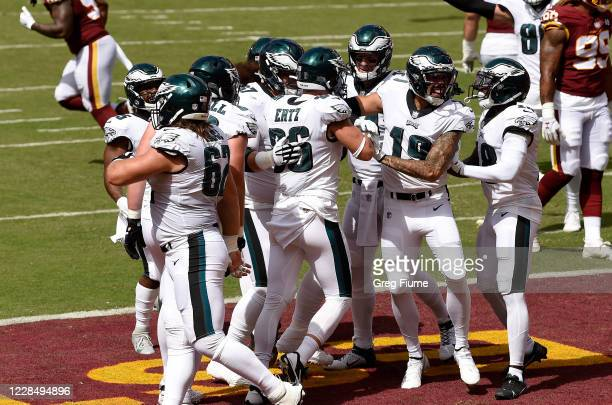 Zach Ertz of the Philadelphia Eagles celebrates with teammates after scoring a touchdown in the first quarter against the Washington Football Team at...