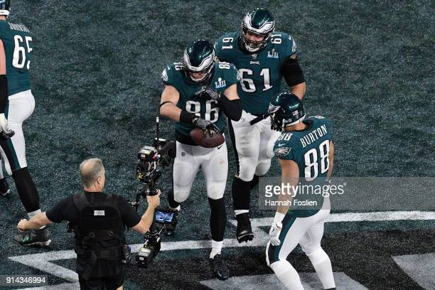 Zach Ertz of the Philadelphia Eagles celebrates with teammates after a 11yard touchdown reception against the New England Patriots during the fourth...