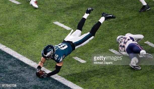 Zach Ertz of the Philadelphia Eagles dives into the end zone for an 11yard touchdown during the game against the New England Patriots in Super Bowl...