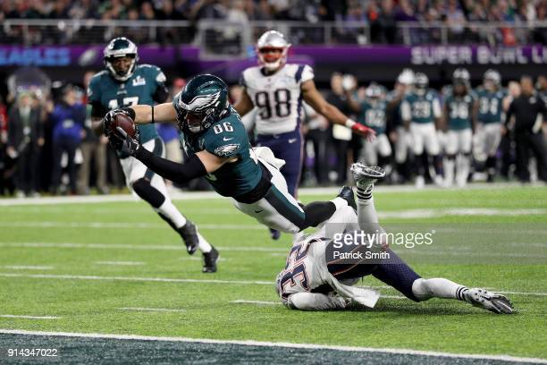 Zach Ertz of the Philadelphia Eagles dives into the endzone for a 11yard touchdown against the New England Patriots during the fourth quarter in...