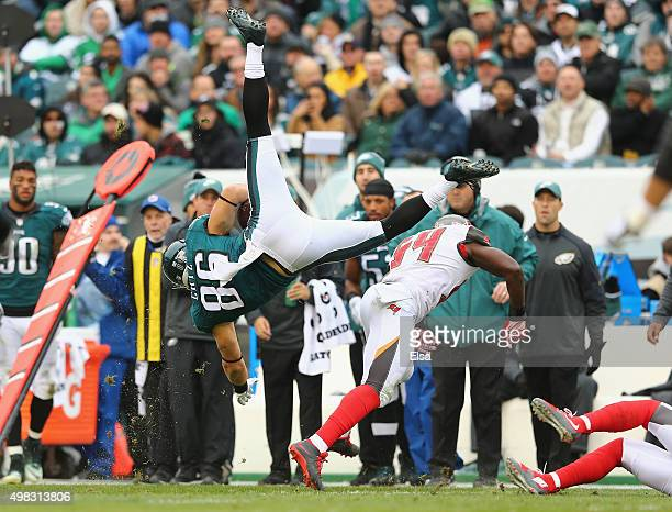 Zach Ertz of the Philadelphia Eagles flies through the air as he makes a reception against Lavonte David of the Tampa Bay Buccaneers in the second...