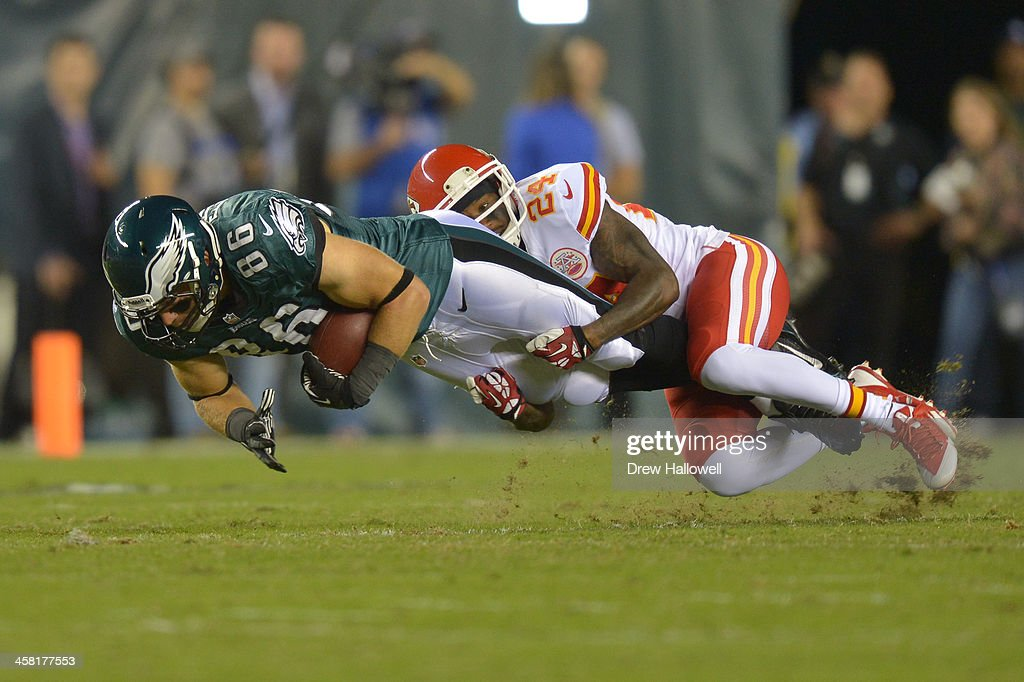 Zach Ertz #86 of the Philadelphia Eagles gets tackled by Brandon Flowers #24 of the Kansas City Chiefs at Lincoln Financial Field on September 19, 2013 in Philadelphia, Pennsylvania. The Chiefs won 26-16.