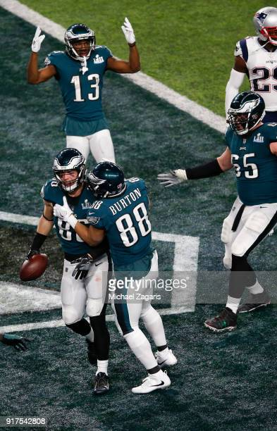 Zach Ertz of the Philadelphia Eagles is congratualted by teammates after scoring on an 11yard touchdown reception during the game against the New...