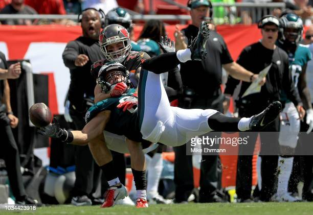 Zach Ertz of the Philadelphia Eagles is held on a catch attempt by Chris Conte of the Tampa Bay Buccaneers during a game at Raymond James Stadium on...