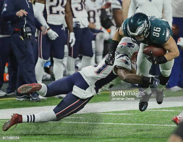 Zach Ertz of the Philadelphia Eagles is hit by Jordan Richards of the New England Patriots during Super Bowl Lll at US Bank Stadium on February 4...
